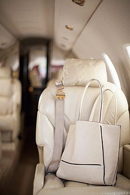 Handbag on seat of luxury private jet - p924m1081833f by Raphye Alexius