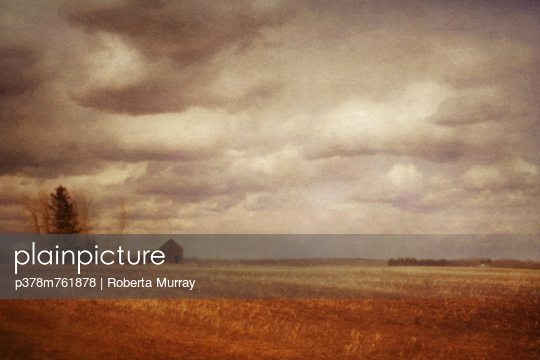 Clouds above farm fields - p378m761878 by Roberta Murray