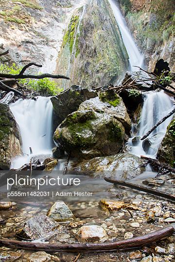 Waterfall on rocks - p555m1482031 by Adam Hester