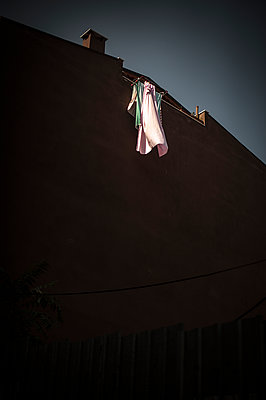 Laundry drying on a wall - p1007m1134821 by Tilby Vattard