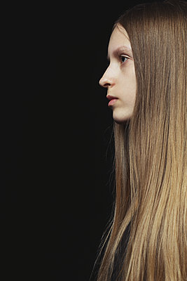 Profile of a young girl with long hair - p1540m2108987 by Marie Tercafs