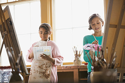 Girls painting in art class - p1192m1023964f by Hero Images