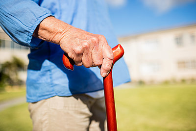Focus on walking stick in a retirement home - p1315m1186286 by Wavebreak