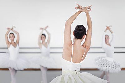 Ballet dancers posing in studio - p42916218f by Hybrid Images