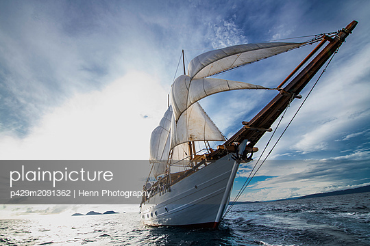 Sail boat in the calm waters of Raja Ampat, Sorong, Nusa Tenggara Barat, Indonesia - p429m2091362 by Henn Photography