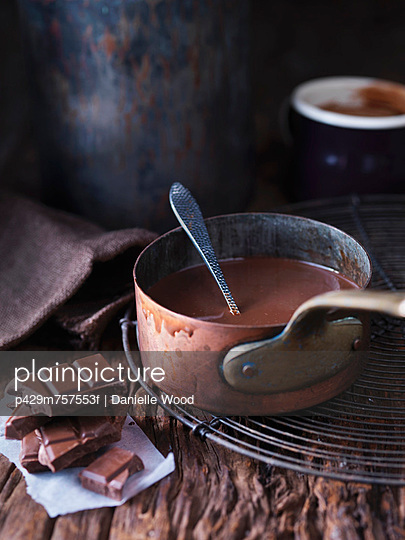 Pan of melted chocolate - p429m757553f by Danielle Wood