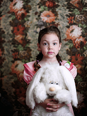 Portrait of a little girl with a cuddly toy in her hands - p1412m1548043 by Svetlana Shemeleva