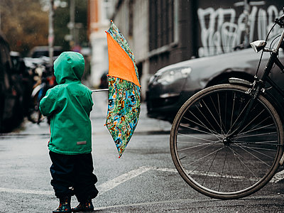 Child in the rain - p1549m2158075 by Sam Green