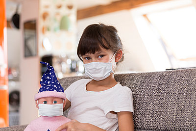 Girl wearing mask at home - p300m2180149 by Stefan Rupp