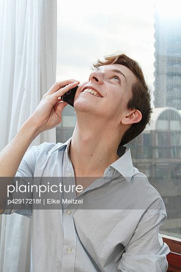 Businessman talking on cell phone - p42917218f by Elke Meitzel