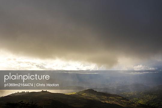 Sun shower over Mongui - p1369m2164474 by Chris Hooton