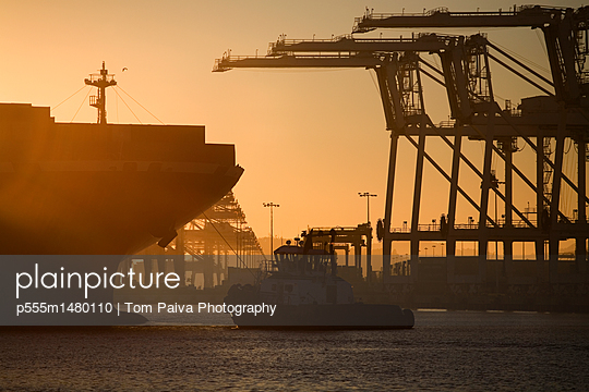 Tugboat and container ship of port of Oakland - p555m1480110 by Tom Paiva Photography