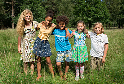 Kids play in the woods - p1132m1152751 by Mischa Keijser