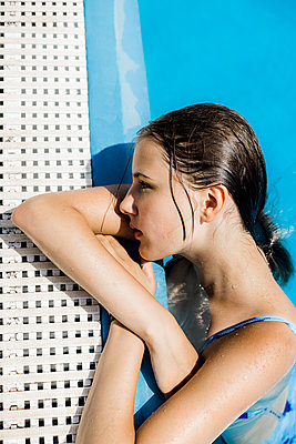 Girl at the edge of the pool - p1621m2291780 by Anke Doerschlen