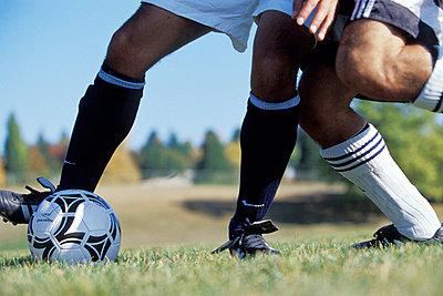 Legs Playing Soccer - p4340768f by Oscar Knott