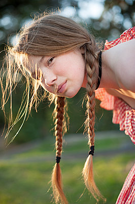 Girl with braids - p920m1573745 by Jude Mooney