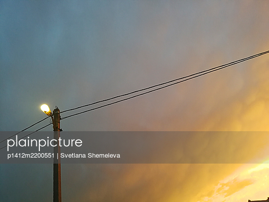 Street lamp against the background of a stormy sky - p1412m2200551 by Svetlana Shemeleva