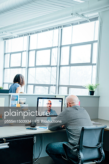 Businessmen on video conference - p555m1503934 by FS Productions