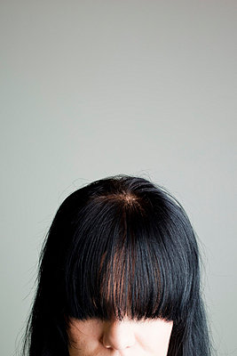 Woman with black hair - p4130751 by Tuomas Marttila