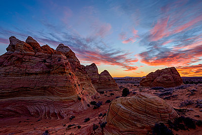 Orange clouds over sandstone cones, Coyote Buttes Wilderness, Vermilion Cliffs National Monument, Arizona, United States of America, North America - p871m975929f by James Hager