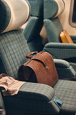 Briefcases on seats in a train - p1540m2259019 by Marie Tercafs