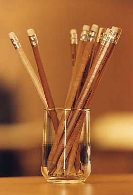 Close-up of pencils in a pencil stand - p3483216 by Anna Hult