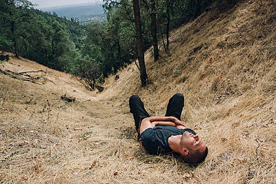Man Resting in Grass - p1262m1087718 by Maryanne Gobble