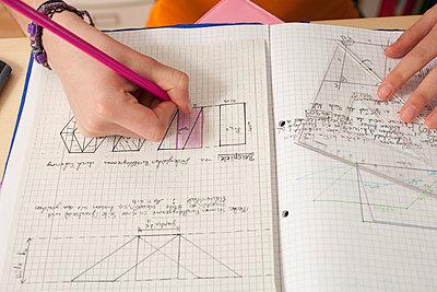 Close up of girl doing math's homework - p609m660397f by STUDD