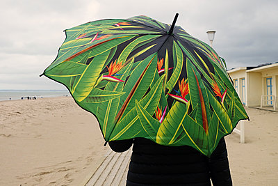 Person with umbrella on beach - p1189m1218669 by Adnan Arnaout