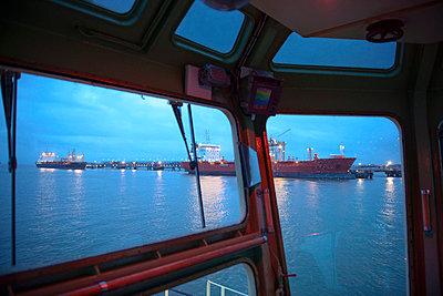 Tanker ships as seen from tugboat - p429m747071f by Monty Rakusen