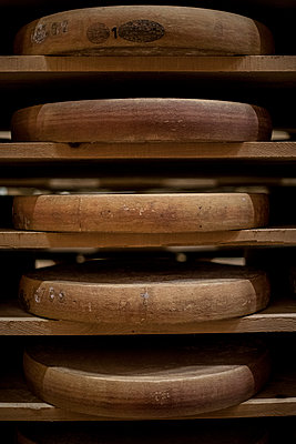 Cheese wheels on a shelf - p445m1496613 by Marie Docher