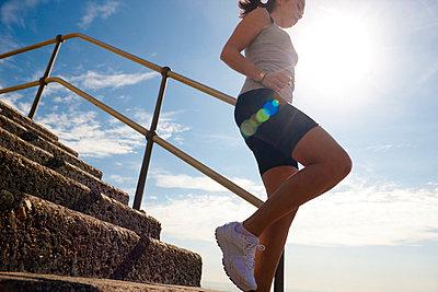 Woman running - p6691611 by Julian Winslow