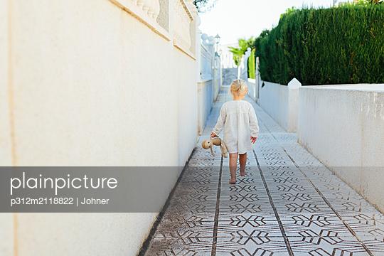 Girl walking - p312m2118822 by Johner