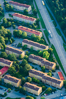 Aerial vie of houses near road - p312m1107618f by Hans Berggren