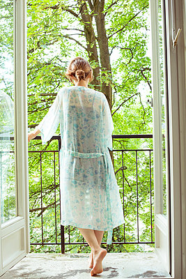Woman on a balcony - p432m912024 by mia takahara