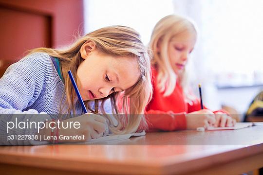 Schoolgirls in classroom - p31227938 by Lena Granefelt