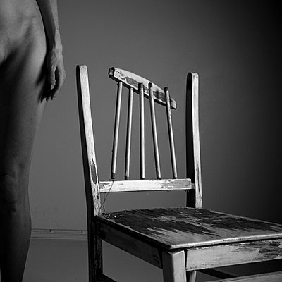 Nude woman with chair - p4130534 by Tuomas Marttila