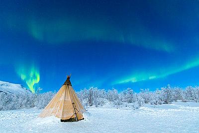 Isolated Sami tent in the snow under Northern Lights (Aurora Borealis), Abisko, Kiruna Municipality, Norrbotten County, Lapland, Sweden, Scandinavia, Europe - p871m1499888 by Roberto Moiola
