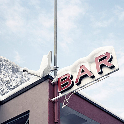 Bar with snow on the top - p9111482 by Gaëtan Rossier