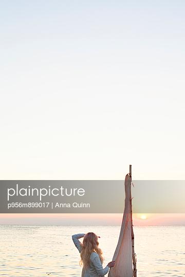 Woman on raft - p956m899017 by Anna Quinn