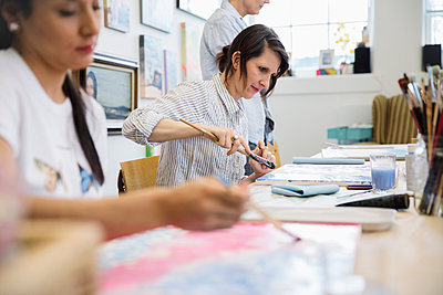 Female artist painting in art class - p1192m2066751 by Hero Images