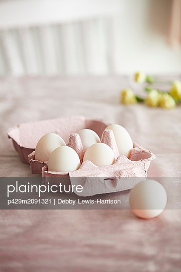 Eggs in pink box - p429m2091321 by Debby Lewis-Harrison