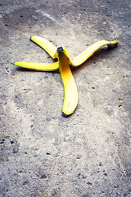 A banana skin on concrete waiting for someone to slip on it - p1302m2081604 by Richard Nixon