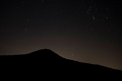 Hill under starry sky - p229m1492013 by Martin Langer
