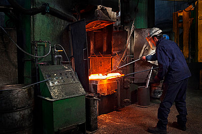 Flight bar (mining component) having been forged in big hammer, is levered off the counterblow hammer, in order to move to clipping press - p429m875668f by Charlie Fawell