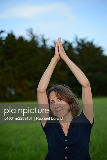 Woman practice yoga - p1631m2289131 by Raphaël Lorand