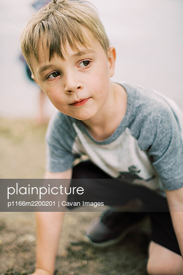 Close up portrait of a boy at the lake - p1166m2200201 by Cavan Images