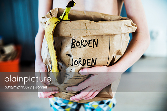 Person holding bag with food waste - p312m2119377 by Johner