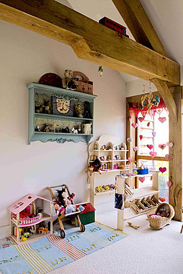 Colourful child's bedroom playroom with storage shelves and toys - p349m790649 by Polly Eltes