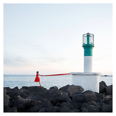 Woman and Lighthouse - p1105m2168872 by Virginie Plauchut